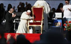 Pope Francis at WYD in Brazil kneeling as the crowd blesses him